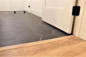 black hex tile with oak flooring