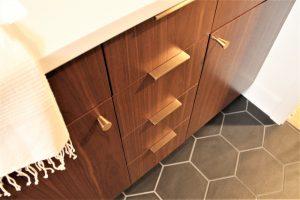 walnut cabinet with brass hardware