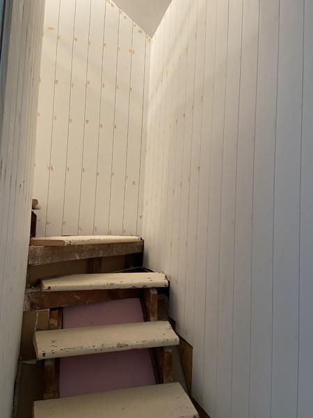 vertical shiplap in stairway