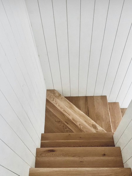white oak stairs with shiplap wall