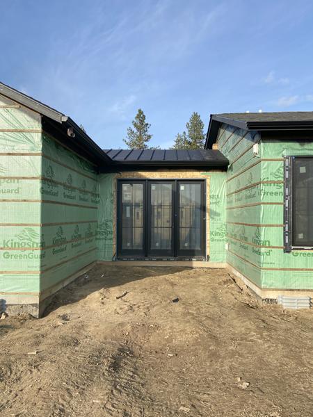 black standing seam metal roof