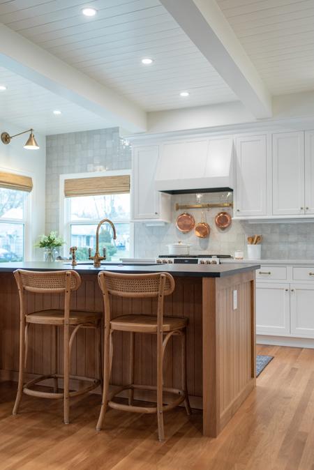 White kitchen with oak island