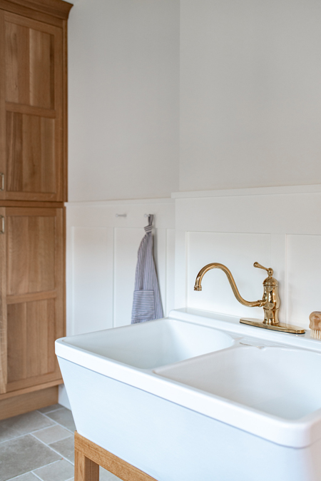 white vintage sink with brass faucet