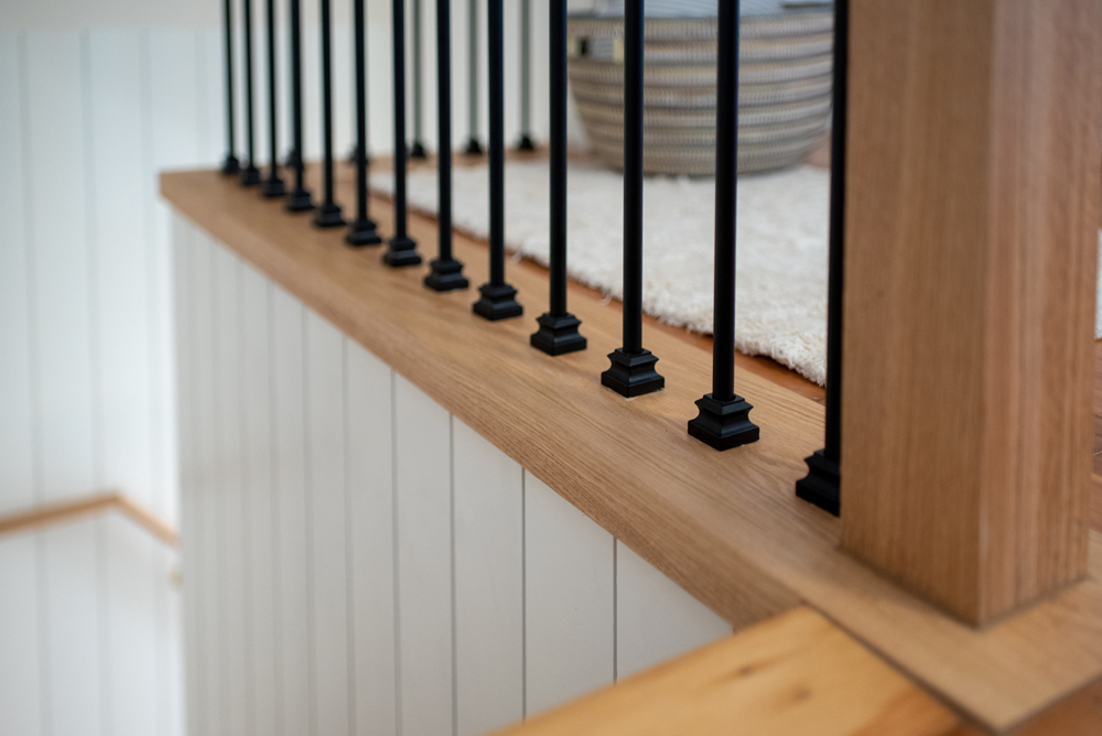 Black metal stair railing with decorative shoe